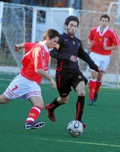 Un lance de un partido entre el CF Damm y el FC Barcelona d. i